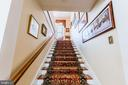 The wide stairway takes you upstairs. - 18490 BLUERIDGE MOUNTAIN RD, BLUEMONT