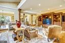 Family room opens to sunroom and kitchen - 11 CLIMBING ROSE CT, ROCKVILLE