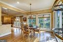Sunroom with hardwoods and crown molding - 11 CLIMBING ROSE CT, ROCKVILLE