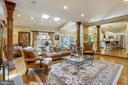 Family room with vaulted ceiling and skylights - 11 CLIMBING ROSE CT, ROCKVILLE