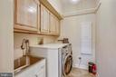 Main floor laundry room off of kitchen - 11 CLIMBING ROSE CT, ROCKVILLE