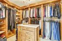 Custom walnut paneled closet with center island - 11 CLIMBING ROSE CT, ROCKVILLE