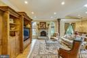 Family room with stone wood burning fireplace - 11 CLIMBING ROSE CT, ROCKVILLE