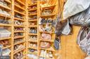 Walnut paneled shoe/purse closet - 11 CLIMBING ROSE CT, ROCKVILLE