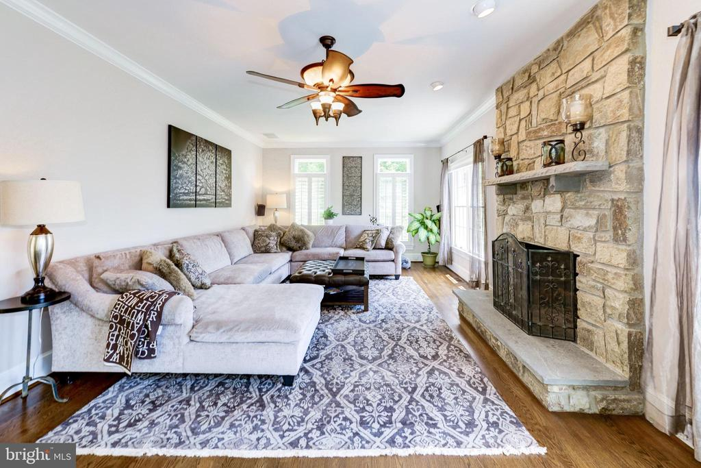 Family room with wood burning stone fireplace - 9496 LYNNHALL PL, ALEXANDRIA
