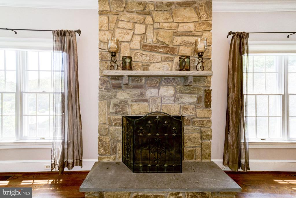 Stone fireplace in family room - 9496 LYNNHALL PL, ALEXANDRIA