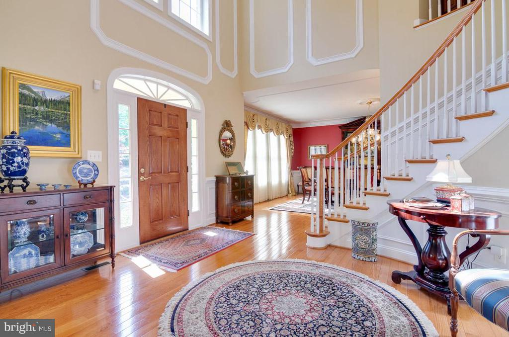 Foyer with crown molding and wainscotting - 1641 WHITE PINE DR, VIENNA