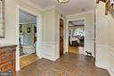 Foyer with rustic  brick flooring - 8317 CATHEDRAL FOREST DR, FAIRFAX STATION