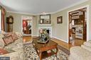 Living room  with warm hardwood floors - 8317 CATHEDRAL FOREST DR, FAIRFAX STATION