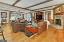 Family room with hardwood flooring and fireplace - 8317 CATHEDRAL FOREST DR, FAIRFAX STATION
