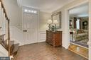 Wainscoting in the foyer - 8317 CATHEDRAL FOREST DR, FAIRFAX STATION