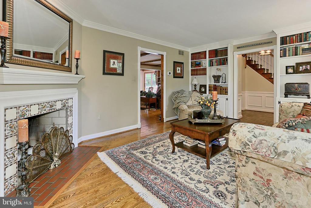 Corner fireplace and built-in-bookcases - 8317 CATHEDRAL FOREST DR, FAIRFAX STATION