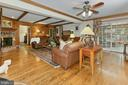 Sliding glass doors opens to screened in porch - 8317 CATHEDRAL FOREST DR, FAIRFAX STATION