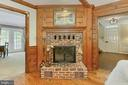 Brick corner  fireplace in family room - 8317 CATHEDRAL FOREST DR, FAIRFAX STATION
