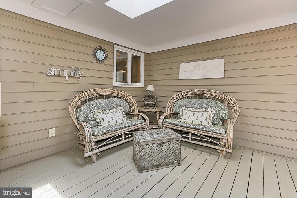 Screened in porch off family room - 8317 CATHEDRAL FOREST DR, FAIRFAX STATION