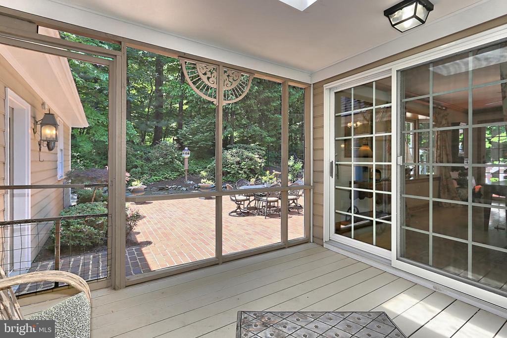 Screened in porch leading to pool - 8317 CATHEDRAL FOREST DR, FAIRFAX STATION