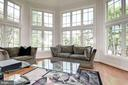 The conservatory offers walls of windows. - 22978 LOIS LN, BRAMBLETON