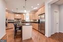 Spacious kitchen with island - 22978 LOIS LN, BRAMBLETON