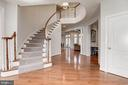 Spacious foyer with elegant curved staircase - 22978 LOIS LN, BRAMBLETON