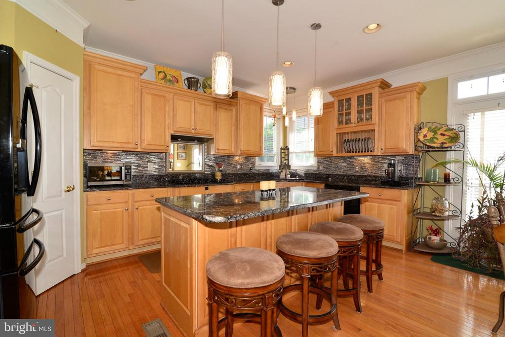 Granite Center Island with bar Stools - 43198 ARBOR GREENE WAY, BROADLANDS