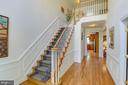 Two-story entrance foyer with extensive woodwork. - 2742 N LEXINGTON ST, ARLINGTON