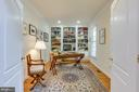 Library with built-in cabinets and bookshelves. - 2742 N LEXINGTON ST, ARLINGTON