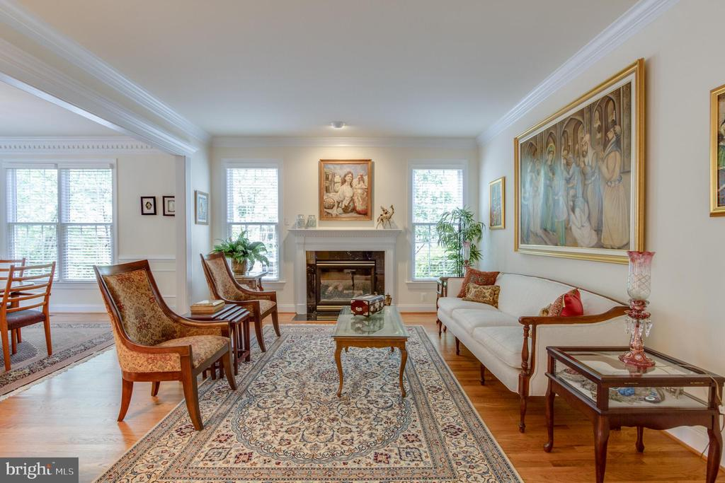Living room with gas fireplace. - 2742 N LEXINGTON ST, ARLINGTON