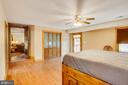 Main-level master bedroom - 10455 WHISPER FARM LN, LOCUST GROVE