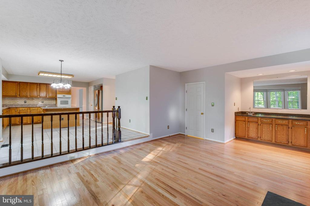 Family Room Opens to Kitchen with Wet Bar - 2332 CLUB POND LN, RESTON