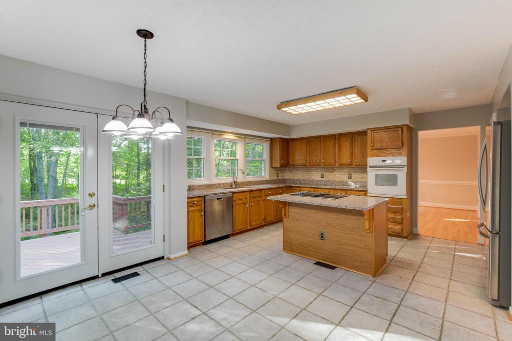 Kitchen Opens to Spacious Deck Shaded with Trees! - 2332 CLUB POND LN, RESTON