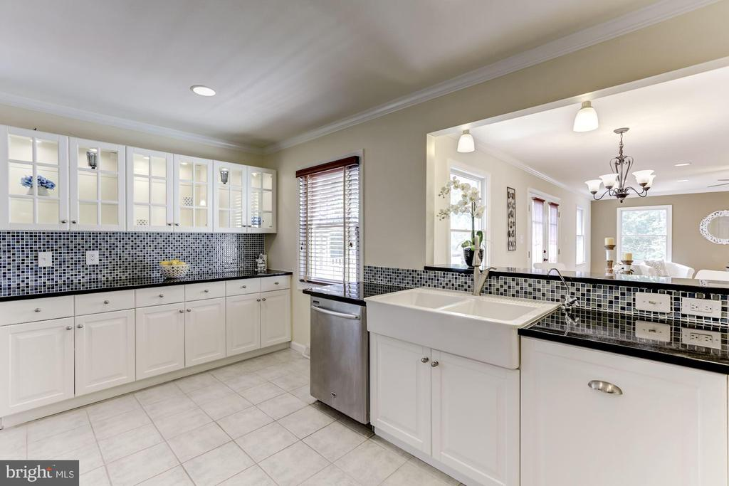 Kitchen opens to dining/living area - 7630 LISLE AVE, FALLS CHURCH