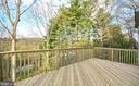 Gorgeous deck surrounded by huge trees - 6442 LAKERIDGE DR, NEW MARKET