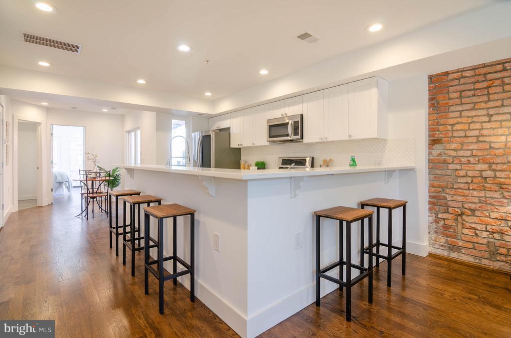 The home's design beckons casual entertaining! - 1412 SHEPHERD ST NW #2, WASHINGTON