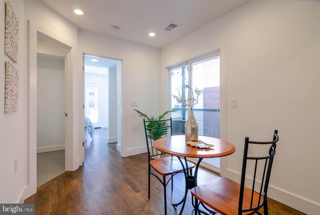 Check out the rich  dark stained floors! - 1412 SHEPHERD ST NW #2, WASHINGTON
