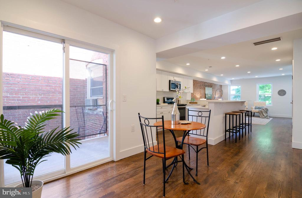 Let the sunshine in & check out the rich dark oak - 1412 SHEPHERD ST NW #2, WASHINGTON