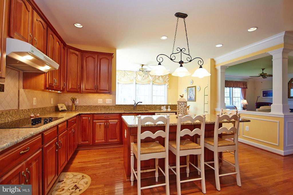 Kitchen w/huge granite island & cherry cabinets - 32315 DEEP MEADOW LN, LOCUST GROVE