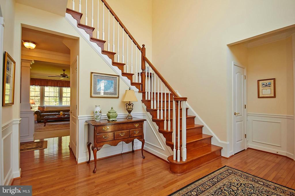 Stairway to upper level - 32315 DEEP MEADOW LN, LOCUST GROVE