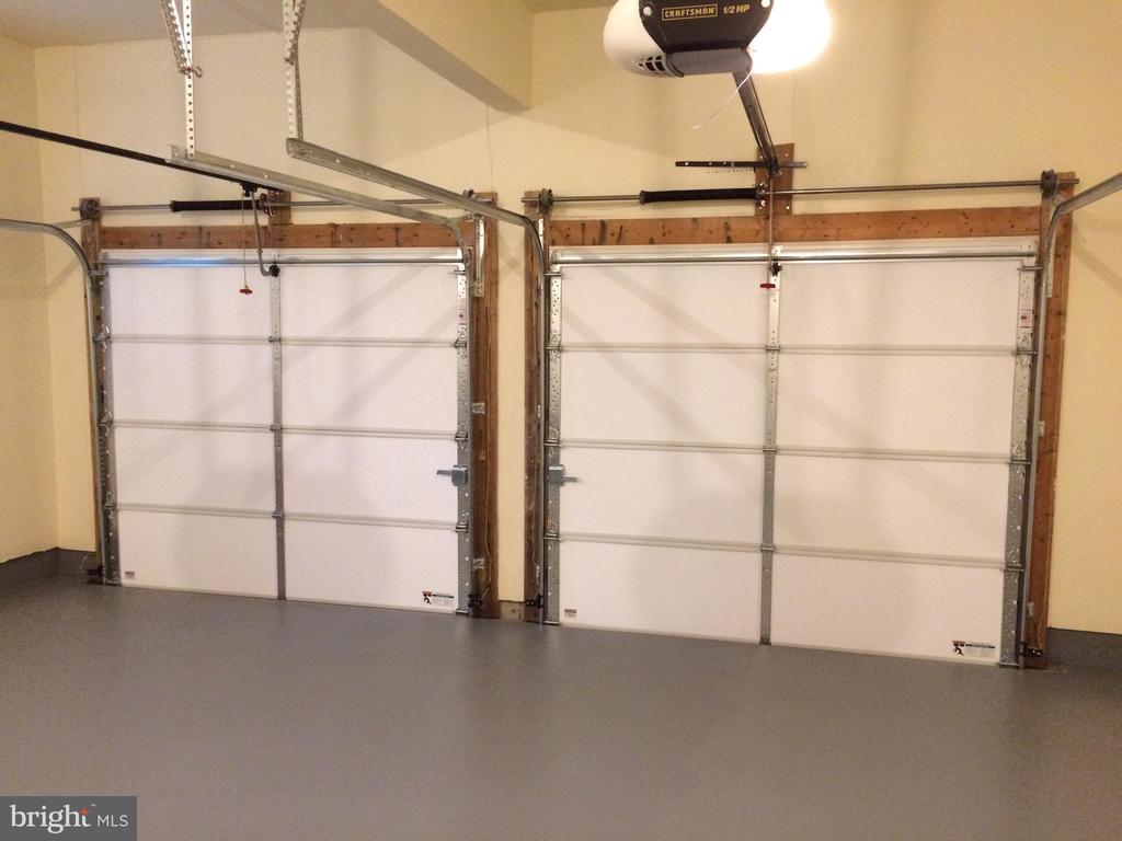 Two new insulated garage doors - 12302 HUNGERFORD MANOR CT, MONROVIA