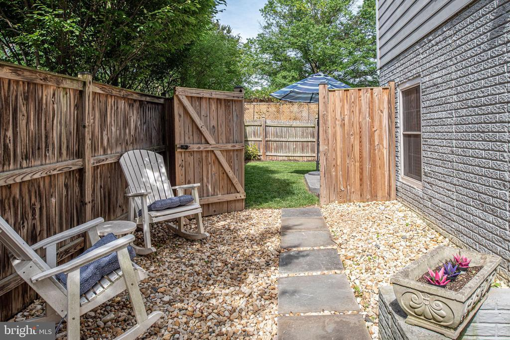 Walk-out rec room connects to flagstone path - 409 N FREDERICK ST, ARLINGTON