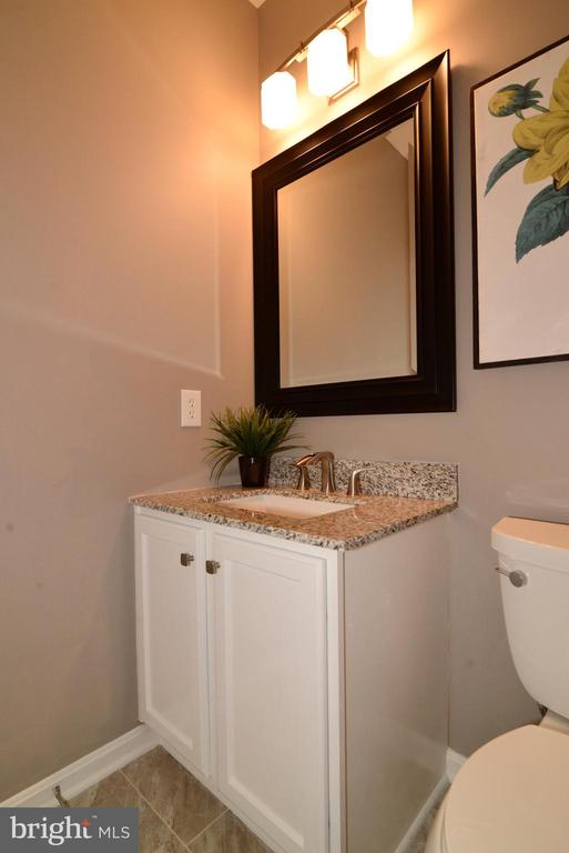Main level powder room with new tile and granite - 21854 KINGS CROSSING TER, ASHBURN