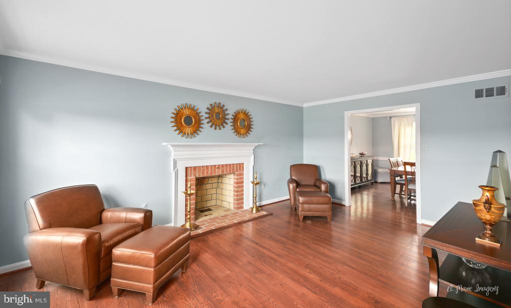 Living room with wood-burning fireplace - 7306 COVENTRY DR, MIDDLETOWN