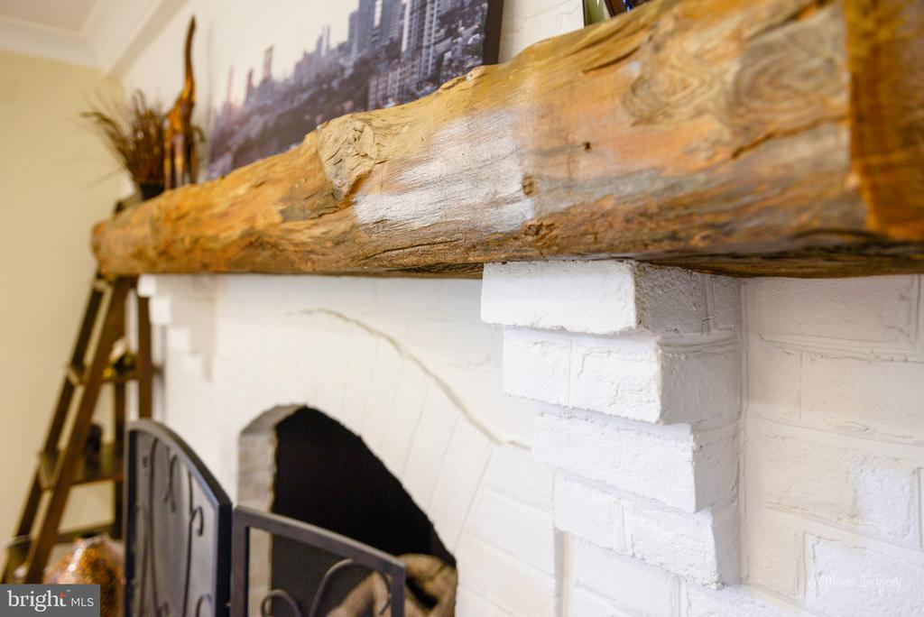 Mantle piece is a beam from the original farmhous - 7306 COVENTRY DR, MIDDLETOWN
