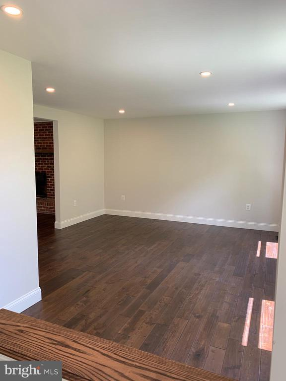 Living room with new hardwood floors. - 14182 WYNGATE DR, GAINESVILLE