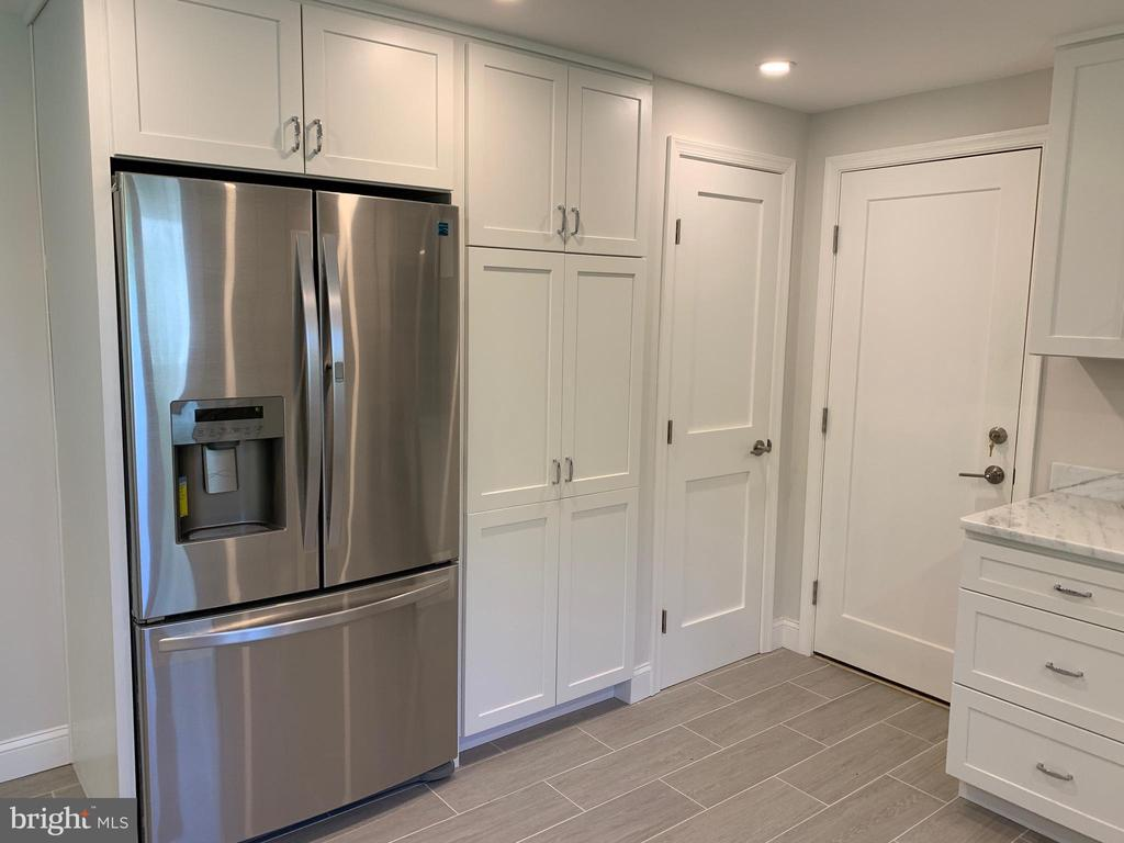 Brand new fridge and large pantry cabinet. - 14182 WYNGATE DR, GAINESVILLE