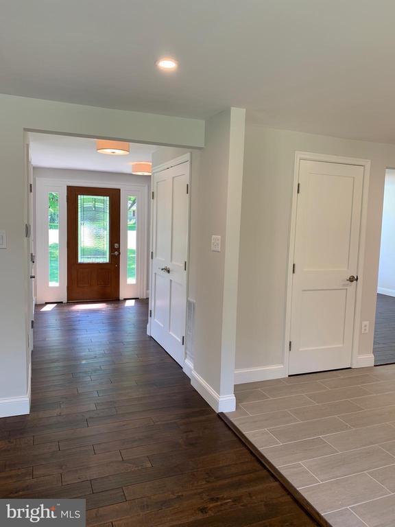New hardwood & front door. - 14182 WYNGATE DR, GAINESVILLE
