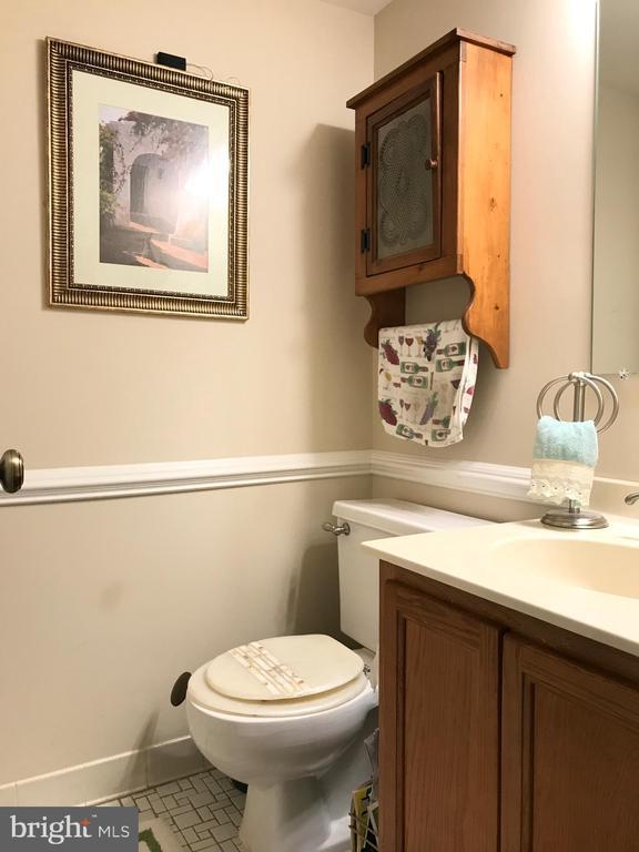 Half bathroom in the basement. - 14864 SWALLOW CT, WOODBRIDGE