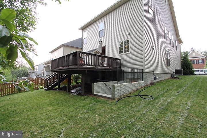 Rear side of home with large deck - 21716 MUNDAY HILL PL, BROADLANDS