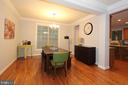 Dining room with gleaming hardwood floors - 21716 MUNDAY HILL PL, BROADLANDS