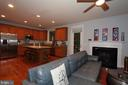 Family room with gas fireplace - 21716 MUNDAY HILL PL, BROADLANDS