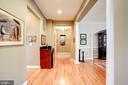 Gallery hallway to Main Level Master suite - 43705 MAHOGANY RUN CT, LEESBURG